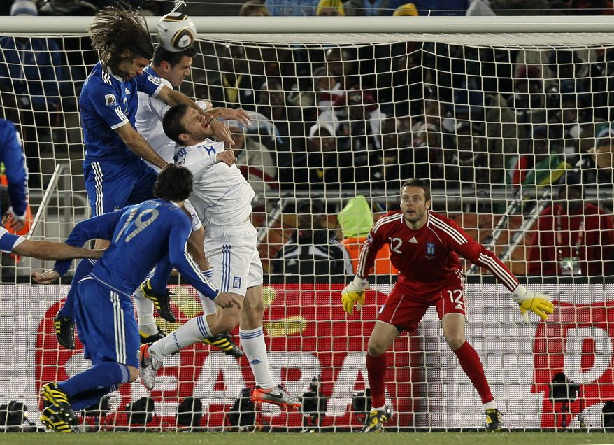 ASSOCIATED PRESS Argentina's Martin Demichelis, left, jumps for the ball with Greece's Avraam Papadopoulos during the World Cup group B soccer match between Greece and Argentina at Peter Mokaba Stadium in Polokwane, South Africa, Tuesday, June 22, 2010.
