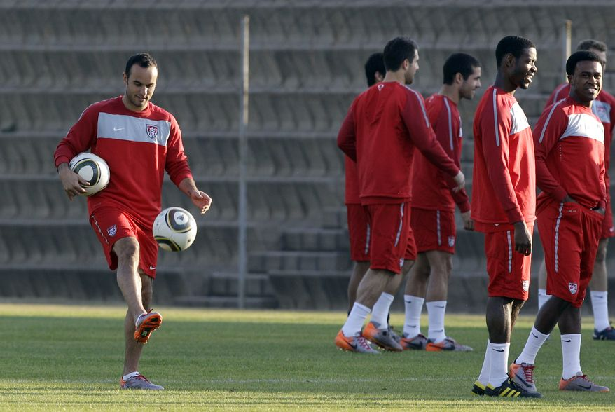 ASSOCIATED PRESS U.S. national soccer midfielder Landon Donovan juggles soccer balls with his teammates nearby during training at Eersterust Stadium in Pretoria, South Africa Tuesday, June 22, 2010. The U.S. team is preparing for their upcoming World Cup Group C match against Algeria on Wednesday.