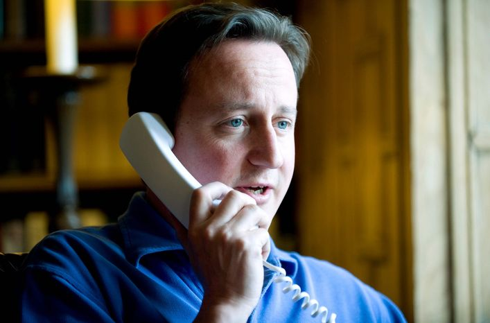 British Prime Minister David Cameron confers by phone with President Obama. Mr. Cameron announced on Wednesday that British Lt. Gen. Nick Parker would temporarily assume Gen. McChrystal's role as commander of NATO forces in Afghanistan. (Bloomberg)