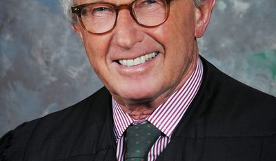 U.S. District Judge Martin L. C. Feldman, who struck down the Obama administration's six-month ban on deepwater oil drilling in the Gulf of Mexico on Tuesday, June 22, 2010, has reported extensive investments in the oil and gas industry. (AP Photo/Office of U.S. District Judge Martin L.C. Feldman)