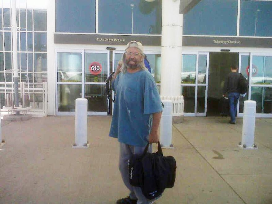 This Sunday, May 30, 2010, photograph provided by Dr. Scott Faulkner shows his brother Gary Faulkner at the Denver International Airport en route to Pakistan. (AP Photo/Dr. Scott Faulkner)