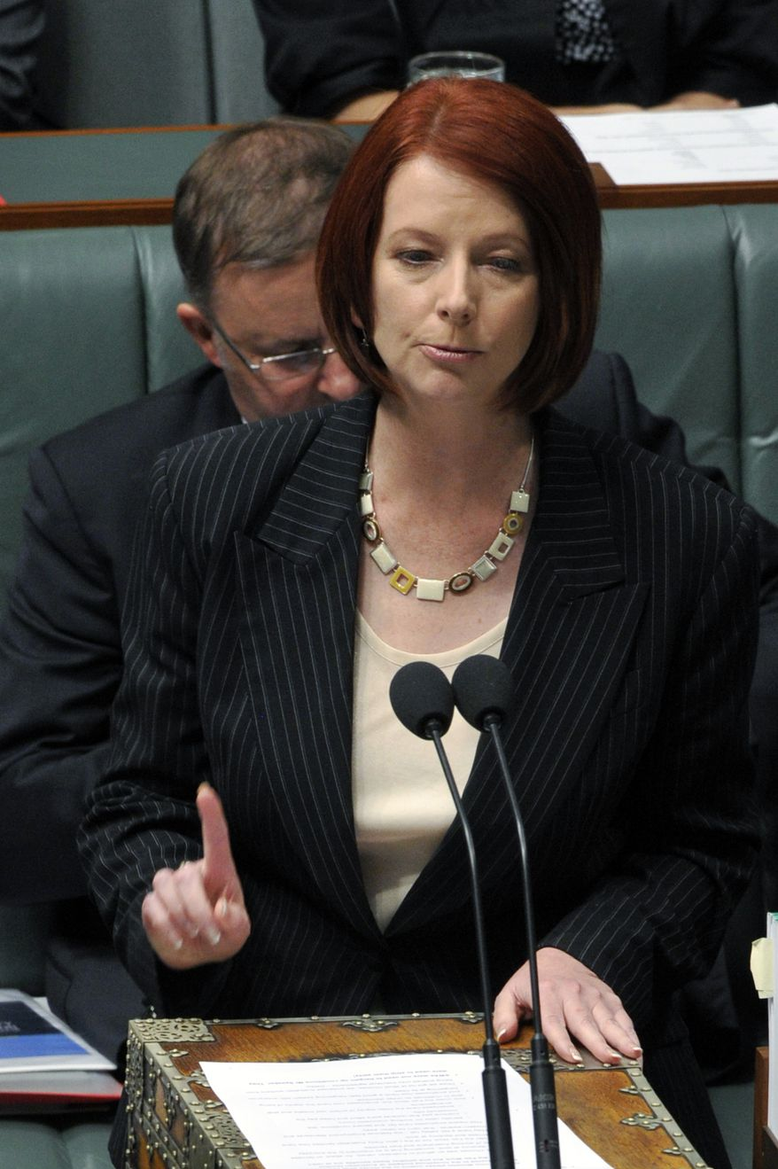 Australia's first female prime minister, Julia Gillard, speaks during a House of Representatives question time at Parliament House in Canberra, Australia, Thursday, June 24, 2010. Ms. Gillard was sworn in leader after the ruling Labor Party ousted Prime Minister Kevin Rudd. (AP Photo/AAP Image, Alan Porritt)