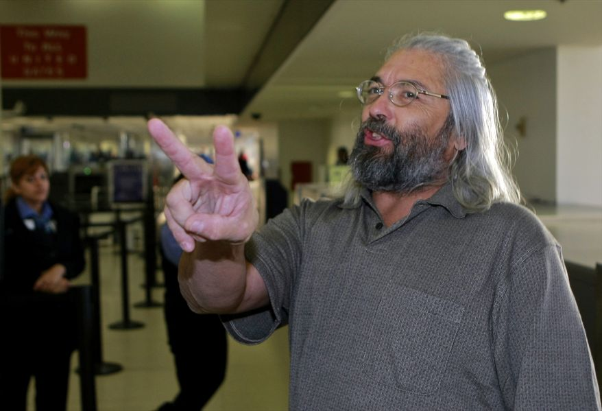 Gary Faulkner gets ready to board a connection flight, back home to Colorado, on Wednesday afternoon, after arriving at Los Angeles International Airport on Wednesday, June 23, 2010, in Los Angeles. Mr. Faulkner, on a solo mission to hunt down Osama bin Laden, is back in the United States, 10 days after authorities found him in the woods of northern Pakistan with a pistol, a sword and night-vision equipment. (AP Photo/Damian Dovarganes)