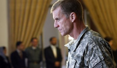 ** FILE ** In this Jan. 20, 2010, file photo, Gen. Stanley McChrystal, then-commander of the International Security Assistance Forces (ISAF) and commander of United States Forces in Afghanistan arrives to attend at the 13th Joint Coordination and Monitoring Board (JCMB) Meeting in Kabul, Afghanistan. (AP Photo/Musadeq Sadeq, File)