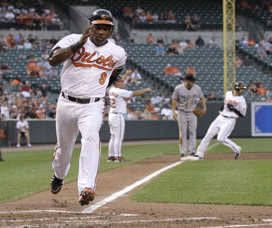 ASSOCIATED PRESS Baltimore Orioles Miguel Tejada scores on a sacrifice fly by Luke Scott during the third inning of a baseball game against the Florida Marlins, Thursday, June 24, 2010, in Baltimore. The Orioles won 11-5.