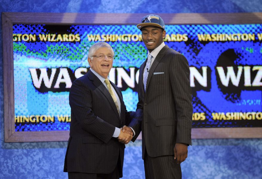 ASSOCIATED PRESS NBA commissioner David Stern, left, poses with the No. 1 overall draft pick John Wall, of Kentucky, who was selected by the Washington Wizards with the No. 1 pick in the NBA basketball draft Thursday, June 24, 2010 in New York.