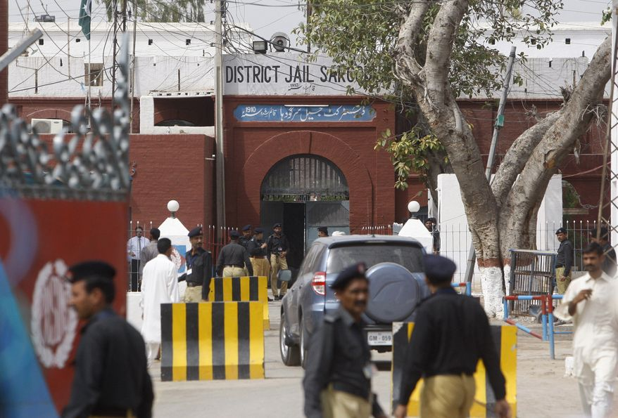 Pakistani police officers stand guard outside the district jail, where five young American Muslims from the Washington, D.C. area who were arrested in Pakistan in December are being held in Sargodha, Pakistan, Thursday, June 24, 2010. The five American men were convicted Thursday on terror charges by a Pakistan court and sentenced to 15 years in prison each, a prosecutor said. The judge handed down two prison terms for each man, one for 10 years and the other for five, said deputy prosecutor Rana Bakhtiar. (AP Photo/Dita Alangkara)