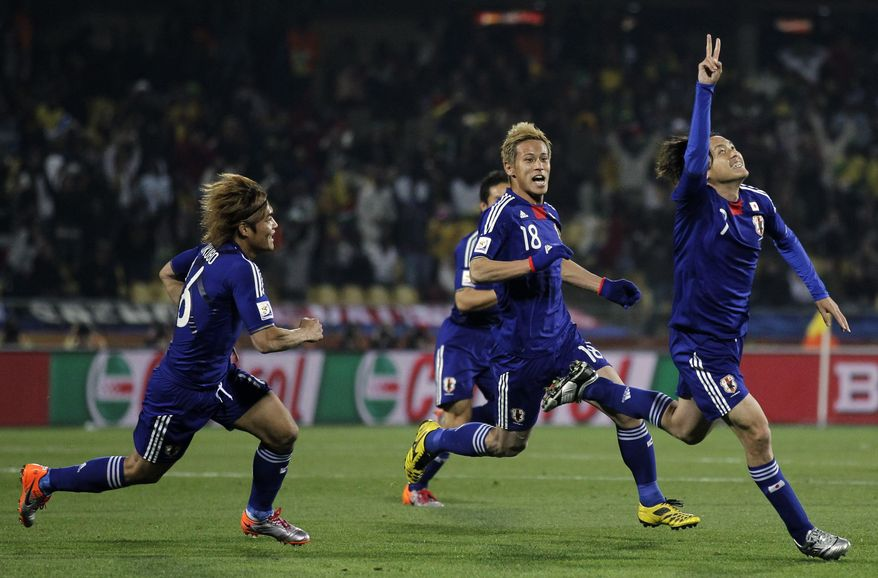 ASSOCIATED PRESS Japan's Yasuhito Endo, right, celebrates after scoring the second goal with fellow team members Keisuke Honda, center, and Yoshito Okubo, left, during the World Cup group E soccer match between Denmark and Japan at Royal Bafokeng Stadium in Rustenburg, South Africa, Thursday, June 24, 2010.