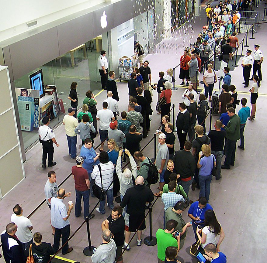 A crowd of potential iPhone 4 customers wait in line to enter the Apple Store, Thursday, June 24, 2010, at the Mall of America in Bloomington, Minn. Over 350 people were waiting in line for the new phone as the store opened at 7 a.m. Apple Inc.'s newest iPhone was selling briskly Thursday as thousands lined up outside stores around the world to become among the first to own the device amid concerns of supply shortages. (AP Photos/Steve Karnowski)