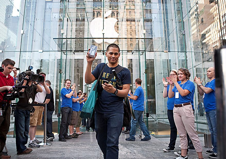 Jeffrey Galvan displays his new iPhone 4 purchased at the Apple Inc. store on Fifth Avenue in New York on Thursday, June 24, 2010. Apple Inc. will probably sell a record 1 million iPhones today with the debut of the new version. Photographer: Ramin Talaie/Bloomberg