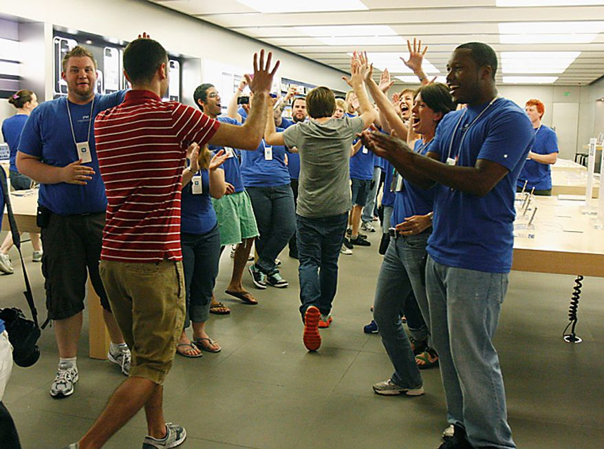 Apple store employees greet some of the first people in line who had prior orders and allowed in the store to get their new iPhone 4, Thursday, June 24, 2010, at Oxmoor Center in Louisville, Ky.  (AP Photo/The Courier-Journal, Pam Spaulding)