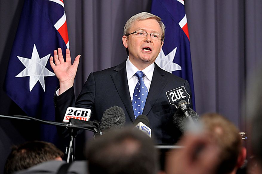 In this Wednesday, June 23, 2010 photo, Australian Prime Minister Kevin Rudd announces in Canberra, Australia, that his party has called a leadership vote just months away from national elections. Australia will have its first woman prime minister on Thursday, as Deputy Prime Minister Julia Gillard has enough support to beat incumbent Kevin Rudd in a Labor Party ballot, several media outlets have reported. (AP Photo/AAP Image, Alan Porritt) **FILE**