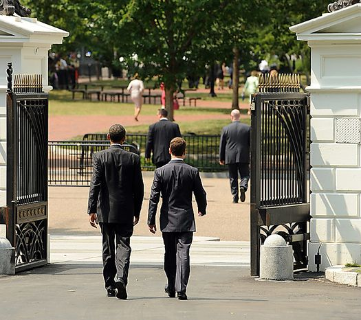 U.S. President Barack Obama (L) and Russian President Dmitry Medvedev walk through the North West Gate of the White House on their way to the U.S. Chamber of Congress to discuss trade issues after their meeting in Washington on June 24, 2010.    UPI/Roger L. Wollenberg