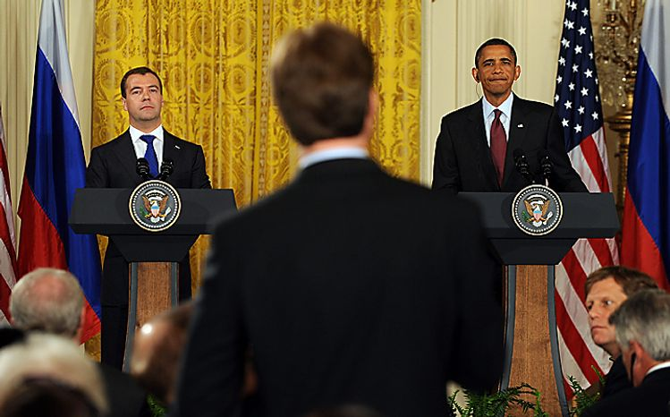 U.S. President Barack Obama and Russian President Dmitry Medvedev take a question from a Russian journalist in the East Room of the White House following their meeting in Washington on June 24, 2010.    UPI/Roger L. Wollenberg