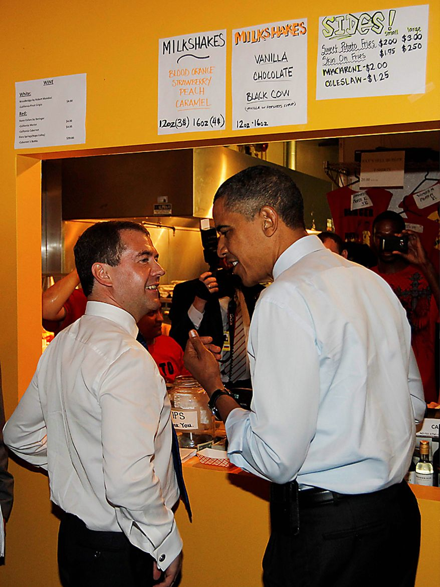 President Barack Obama and Russia's President Dmitry Medvedev order burgers during an unscheduled visit to Ray's Hell Burger in Arlington, Va., Thursday, June 24, 2010. (AP Photo/Charles Dharapak)