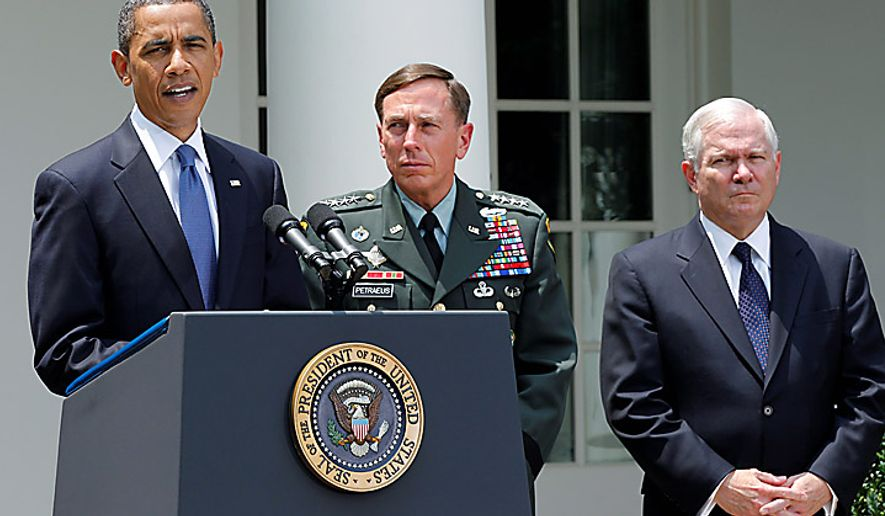 **FILE** President Barack Obama, accompanied by Gen. David Petraeus (center) and Defense Secretary Robert Gates, announces in the Rose Garden of the White House on June 23, 2010, that Gen. Petraeus would replace Gen. Stanley McChrystal. (Associated Press)