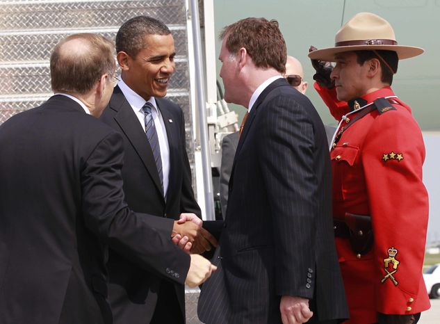President Obama is greeted upon his arrival in Toronto, Friday, June 25, 2010, for the World Summit. (AP Photo/Charles Dharapak)