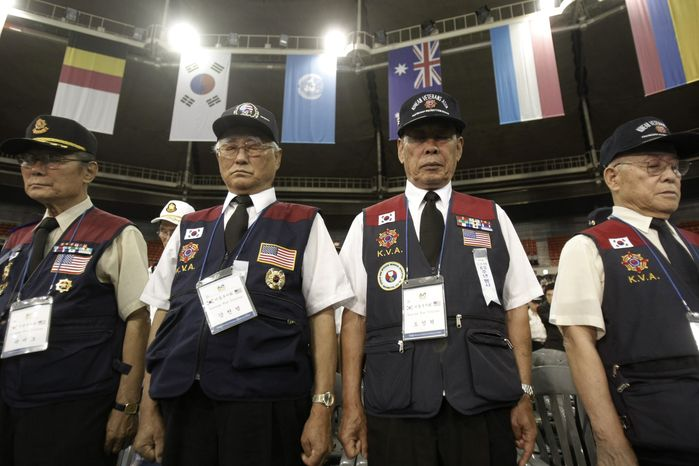 Korean War veterans pay their respects during a ceremony to mark the 60th anniversary of the outbreak of the Korean War in Seoul, South Korea, Friday, June 25, 2010. The two Koreas commemorated the anniversary Friday of the war, promoting vastly different views of the origins of the conflict that still divides their peninsula a full six decades later. (AP Photo/Ahn Young-joon)