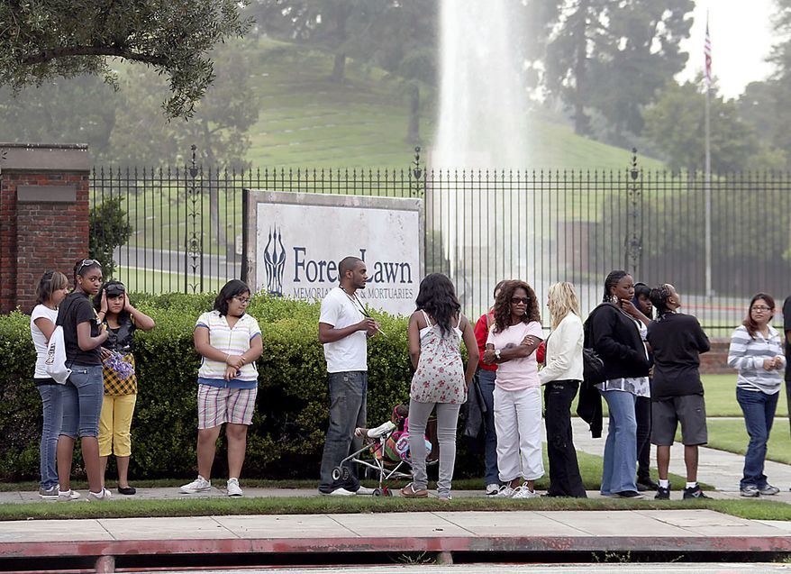 Michael Jackson fans gather outside Forest Lawn cemetery  in Glendale, Calif., Friday, June 25, 2010, to mark the first year anniversary of Jackson's death. (AP Photo/Nick Ut)