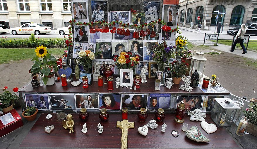 A memorial for pop music icon Michael Jackson in Munich, southern Germany, on Thursday, June 24, 2010. The death of Jackson, one year later, continues to captivate the world. (AP Photo/Matthias Schrader)