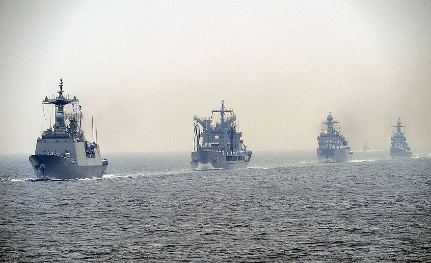 South Korean Navy warships parade off southeastern coast near Busan, South Korea, to mark the 60th anniversary of the Korean War on Friday, June 25, 2010. The two Koreas commemorated the anniversary Friday of the outbreak of the war, promoting vastly different views of the origins of the conflict that still divides their peninsula a full six decades later. (AP Photo/Yonhap, Jo Jung-hoo)