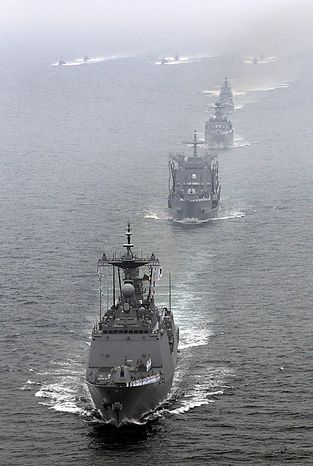 South Korean Navy warships parade off southeastern coast near Busan, South Korea, to mark the 60th anniversary of the Korean War on Friday, June 25, 2010. The two Koreas commemorated the anniversary Friday of the outbreak of the