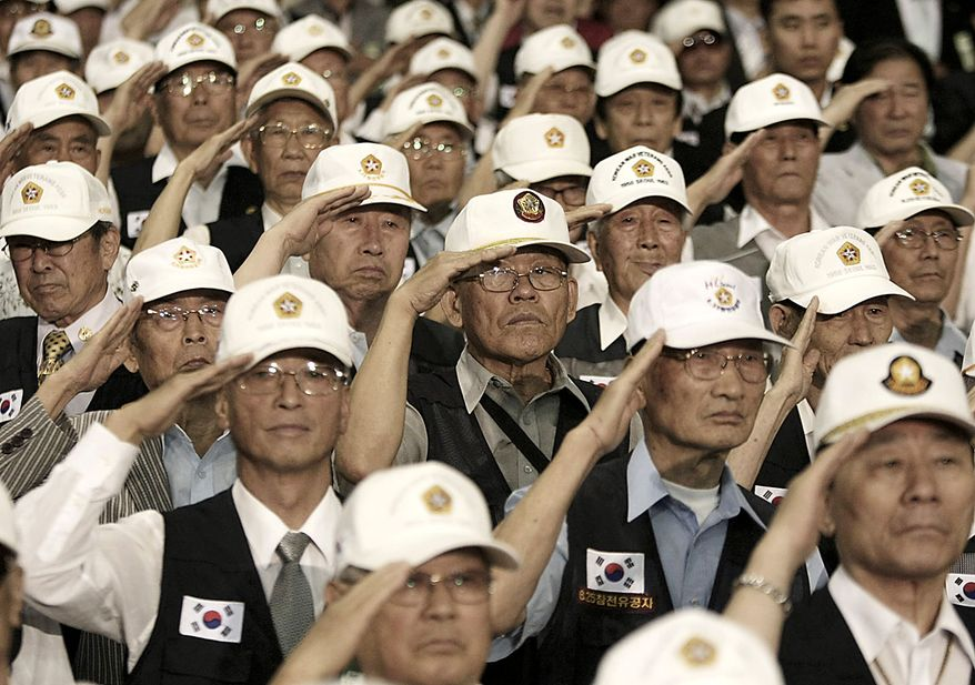 Korean War veterans salute during a ceremony to mark the 60th anniversary of the outbreak of the Korean War in Seoul, South Korea, Friday, June 25, 2010. The two Koreas commemorated the anniversary Friday of the war, promoting vastly different views of the origins of the conflict that still divides their peninsula a full six decades later. (AP Photo/Ahn Young-joon)