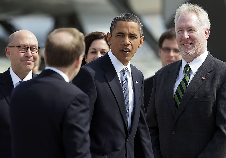 President Obama is greeted on the tarmac by David Jacobson, the U.S. ambassador to Canada, left, Chief of Protocol Robert William Peck, second from left, and U.S. Consul General Kevin Johnson, right, as he arrives at Pearson International Airport in Toronto, Friday, June 25, 2010, for the G-8 and G-20 Summit. (AP Photo/Carolyn Kaster)