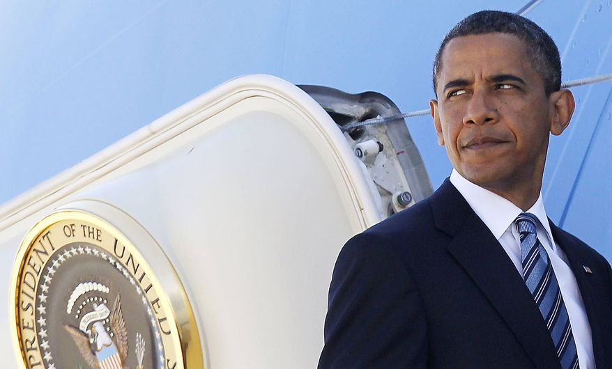 President Obama boards Air Force One at Andrews Air Force Base, Md., Friday, June 25, 2010, en route to Canada for the G-20 summit. (AP Photo/Charles Dharapak)