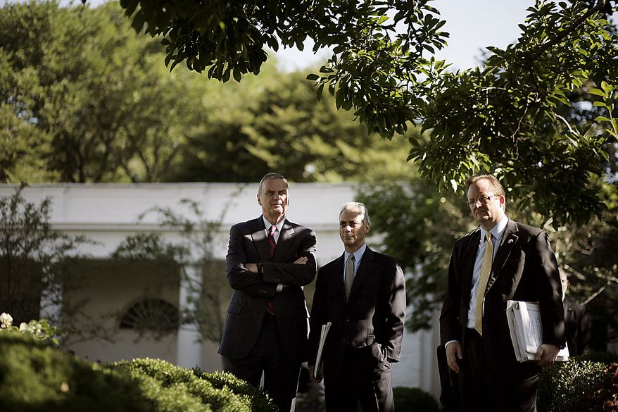 From left, National Security Adviser James Jones, White House Chief of Staff Rahm Emanuel and White House press secretary Robert Gibbs, listen to President Obama speak to members of the media on the South Lawn of the White House in Washington, Friday, June 25, 2010, before traveling to Canada to attend the G-20 summit. (AP Photo/Pablo Martinez Monsivais)