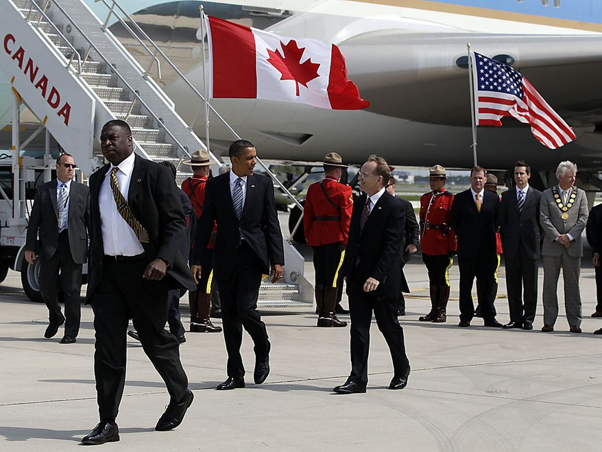 President Obama walks across the tarmac with Chief of Protocol Robert William Peck, as he arrives at Pearson International Airport in Toronto, Friday, June 25, 2010, for the G-8 and G-20 summit. (AP Photo/Carolyn Kaster)