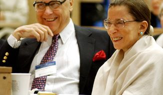 **FILE** In this Sept. 12, 2003 photo, Supreme Court Justice Ruth Bader Ginsburg (right) laughs with her husband Martin as they listen to Justice Stephen Breyer speak at Columbia Law School. The occasion celebrated the 10th anniversary of her appointment to the Supreme Court of the United States. (Associated Press)