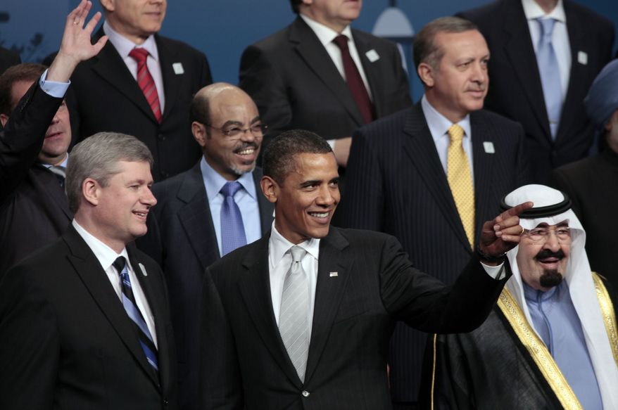 President Obama (center) is joined Sunday by Canadian Prime Minister Stephen Harper (left), Ethiopian Prime Minister Meles Zenawi, Turkish Prime Minister Recep Tayyip Erdogan (upper right) and King Abdullah of Saudi Arabia during the official family photo at the G20 Summit in Toronto. (AP Photo/Lefteris Pitarakis)