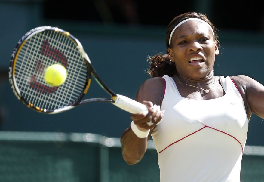 ASSOCIATED PRESS Serena Williams makes a forehand return to Maria Sharapova of Russia, during their women's singles match on the Centre Court at the All England Lawn Tennis Championships at Wimbledon, Monday, June 28, 2010.