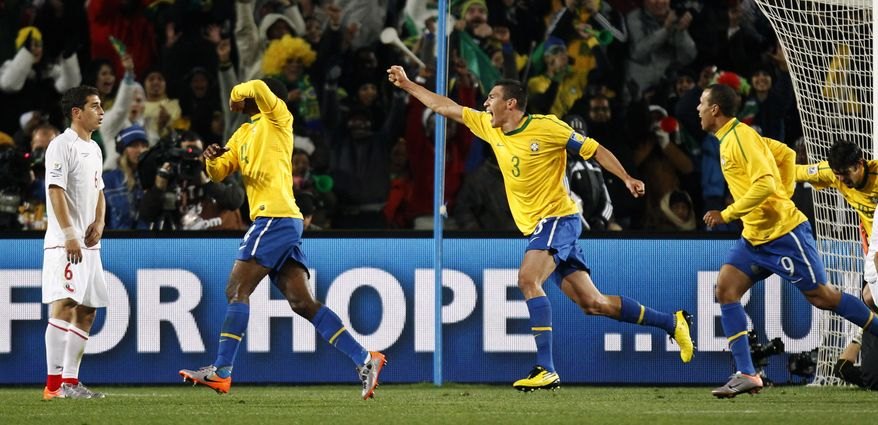 ASSOCIATED PRESS Brazil's Juan, second from left, celebrates after scoring a goal with fellow team members Lucio, third from right, Luis Fabiano, second from right, and Kaka, right, as Chile's Carlos Carmona, left, reacts during the World Cup round of 16 soccer match between Brazil and Chile at Ellis Park Stadium in Johannesburg, South Africa, Monday, June 28, 2010.