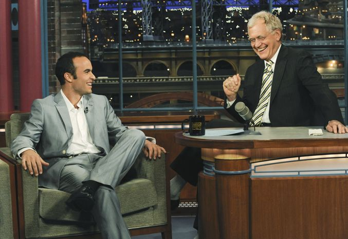 """ASSOCIATED PRESS In this photo released by CBS, U.S. World Cup soccer team midfielder Landon Donovan, left, talks with host David Letterman on the set of the """"Late Show with David Letterman,"""" Tuesday, June 29, 2010, in New York. Donovan, a key player for Major League Soccer's Los Angeles Galaxy, scored three of the U.S. team's five goals in 2010 World Cup, including a last-minute score against Algeria that sent the team into the second round of tournament play."""