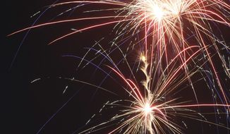 ** FILE ** This July 4, 2008 file photo shows fireworks as they burst in the night sky of Bullard, Texas as part of its Independence Day celebration.  (AP Photo/Dr. Scott M. Lieberman, FILE) A program that offers free cab rides home to people in the Washington region who have been drinking too much around certain holidays has been salvaged for Independence Day.