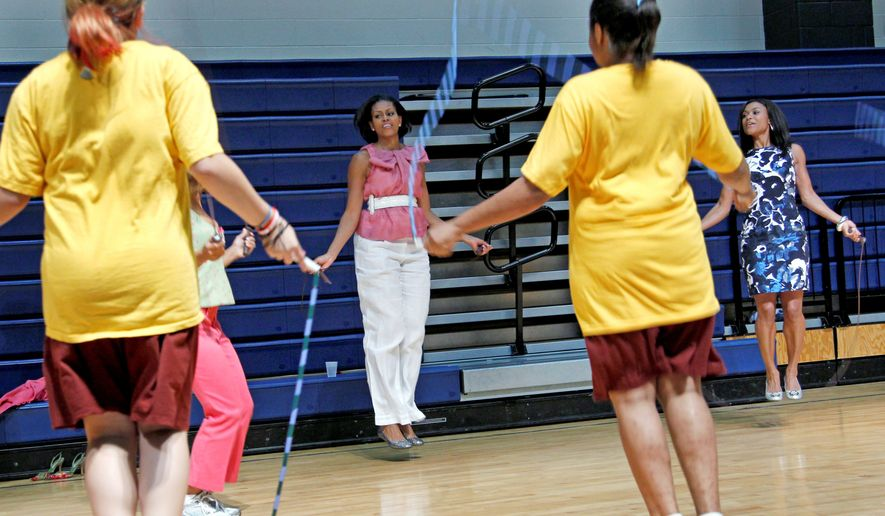 """First lady Michelle Obama jumps rope Wednesday with students in Washington, D.C. Mrs. Obama's """"Let's Move"""" initiative aims to increase awareness and decrease the rate of obesity. (Associated Press)"""