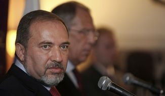 Israeli Foreign Minister Avigdor Lieberman (left) speaks as his Russian counterpart, Sergey Lavrov, looks on at a press conference following their meeting in Jerusalem on Tuesday, June 29, 2010. (AP Photo/Tara Todras-Whitehill)