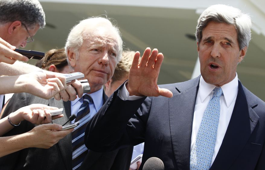 Sen. John Kerry, Massachusetts Democrat, accompanied by Sen. Joseph I. Lieberman, Connecticut Independent., speaks to reporters outside the White House in Washington, Tuesday, June 29, 2010, after meeting with President Obama to discuss passing comprehensive energy and climate legislation. (AP Photo/Charles Dharapak)