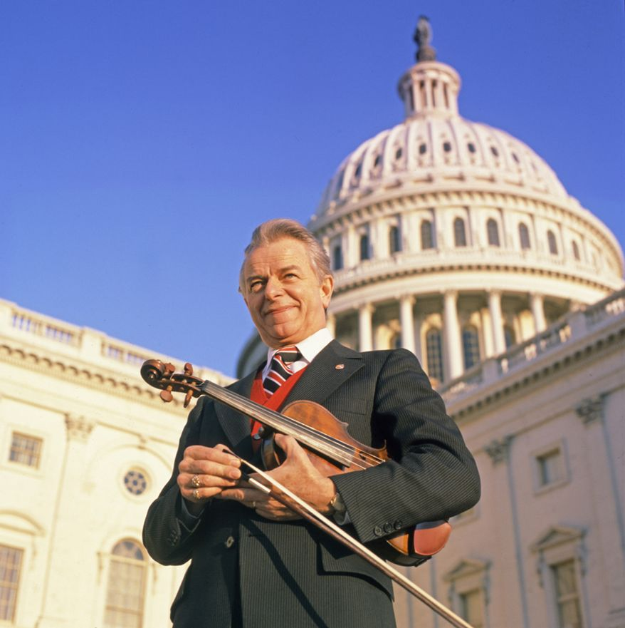 "In a 1977 photo provided by County Records, Sen. Robert C. Byrd, West Virginia Democrat, posed in front of the capitol building with his fiddle. The photo will adorn the cover of a re-issue of an album produced by Mr. Byrd called ""Mountain Fiddler."" Mr. Byrd won his first race, for the state's House of Delegates, in 1946, distinguishing himself from 12 rivals by singing and fiddling mountain tunes. He died Monday, June 28, 2010 at the age of 92. (AP Photo/County Records, Carl Fleischhauer)"