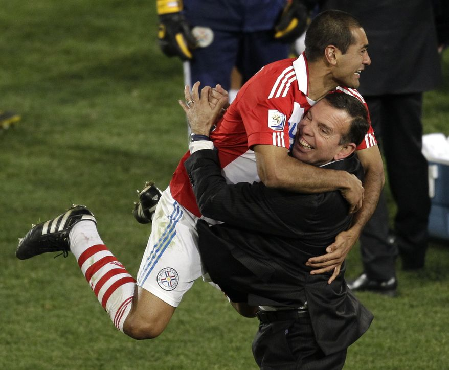 ASSOCIATED PRESS Paraguay's Nelson Haedo Valdez, left, celebrates with a fellow team member following the World Cup round of 16 soccer match between Paraguay and Japan at the Loftus Versfeld Stadium in Pretoria, South Africa, Tuesday, June 29, 2010. Paraguay advanced to the World Cup quarterfinals for the first time with a 5-3 victory over Japan in penalty kicks after a 0-0 draw.