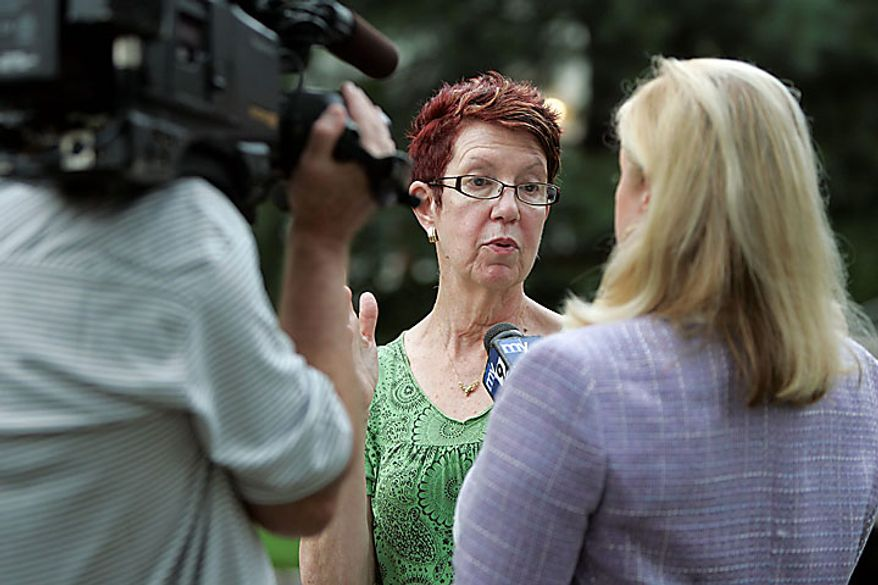 """Margo Sokolow is interviewed by the media in front of her home on Marquette Road in Montclair, N.J., on Monday, July 28, 2010. Her neighbors, """"Richard Murphy"""" and """"Cynthia Murphy,"""" were arrested by the FBI at their house on Sunday. (AP Photo/Rich Schultz)"""