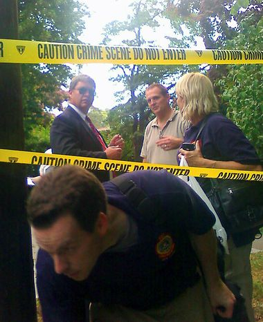 """FBI agents gather in front of the two-story residence in Yonkers, N.Y., where two suspected Russian secret agents Vicky Pelaez and a man known as """"Juan Lazaro"""" were arrested on Monday June 28, 2010. The FBI has arrested 10 people for allegedly serving for years as secret agents of Russia's intelligence service, the SVR, with the goal of penetrating U.S. government policymaking circles. (AP Photo/The Journal News, Shawn Cohen)"""