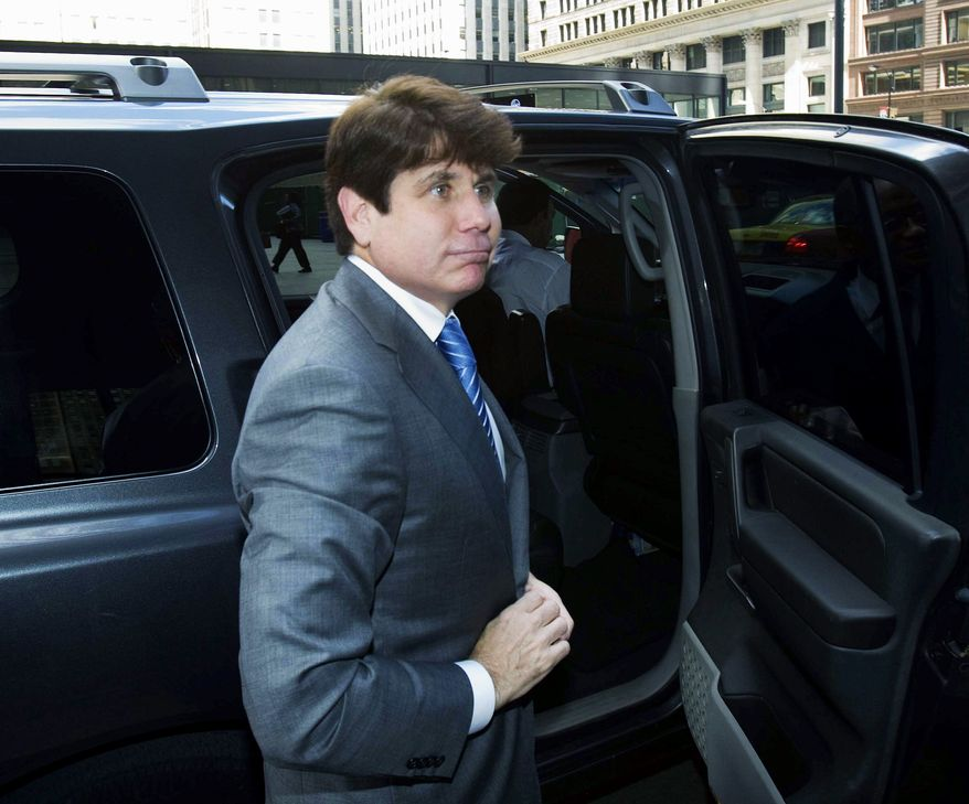ON TAPE: Ousted Illinois Gov. Rod R. Blagojevich arrives at federal court Wednesday in Chicago for his corruption trial. He is featured on FBI tapes being played in court. (Associated Press)