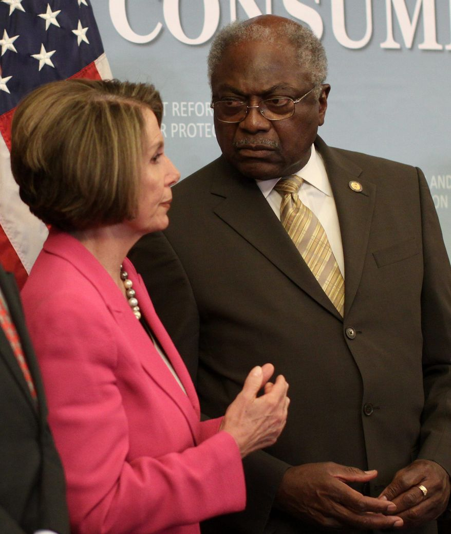 House Speaker Nancy Pelosi of California talks with House Majority Whip James E. Clyburn of South Carolina on Capitol Hill on Wednesday during a news conference to announce that the House passed a massive overhaul of financial regulations. (Associated Press)