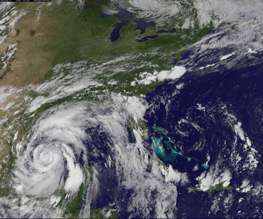 This image provided by NOAA was acquired Tuesday June 29, 2010, at 5:32 p.m. EDT shows Hurricane Alex churning through the western Gulf, taking aim at the Mexico-Texas border and far away from the massive oil spill. (AP Photo/NOAA)
