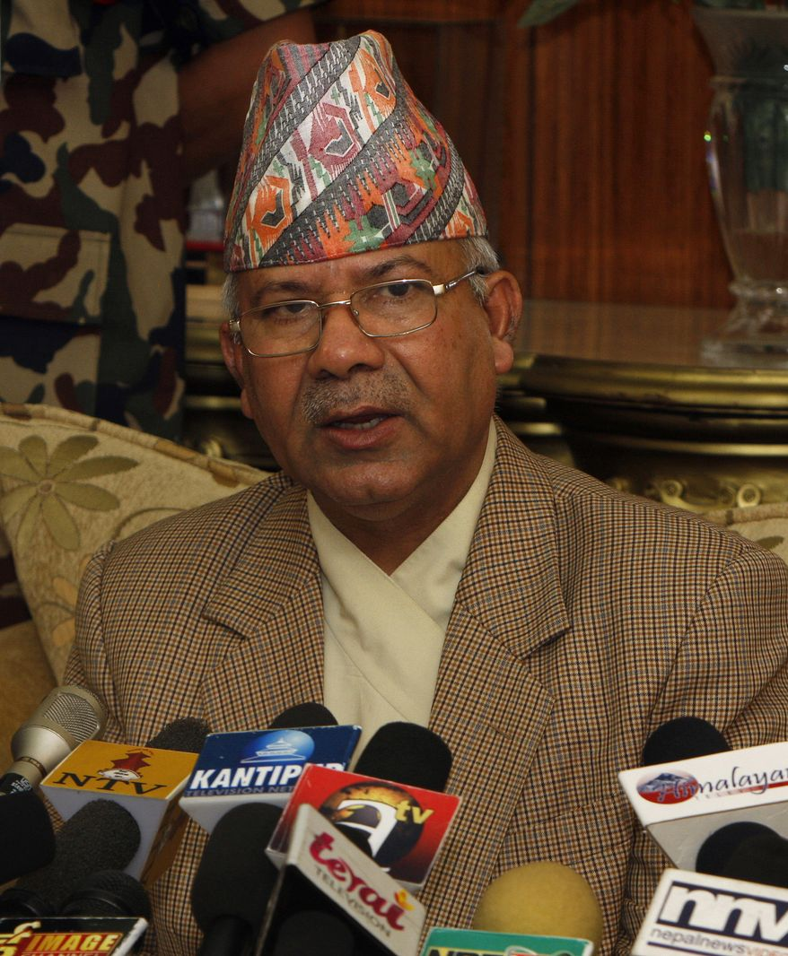 Nepali Prime Minister Madhav Kumar Nepal speaks during a televised speech at his official residence in Katmandu, Nepal, on Wednesday, June 30, 2010. Nepal announced his resignation, bowing to pressure from opposition Maoists who have been demanding his ouster in parliament and on the streets. (AP Photo/Binod Joshi)