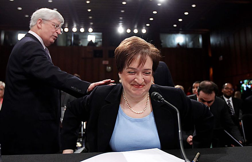Supreme Court nominee Elena Kagan gets a pat on her back as she takes her seat on Capitol Hill in Washington, Wednesday, June 30, 2010, prior to the start of her confirmation before the Senate Judiciary Committee. (AP Photo/Alex Brandon)