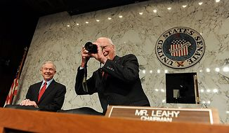 Committee Chair Sen. Patrick J. Leahy, Vermont Democrat, takes a photo as ranking member Sen. Jeff Sessions, Alabama Republican, smiles as they wait for Supreme Court nominee Elena Kagan, President Obama's pick to replace retiring Justice John Paul Stevens, to testify on the third day of her confirmation hearing before the Senate Judiciary Committee on Capitol Hill in Washington on June 30, 2010.    UPI/Roger L. Wollenberg